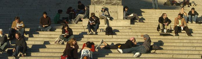 students sitting on Low Library steps
